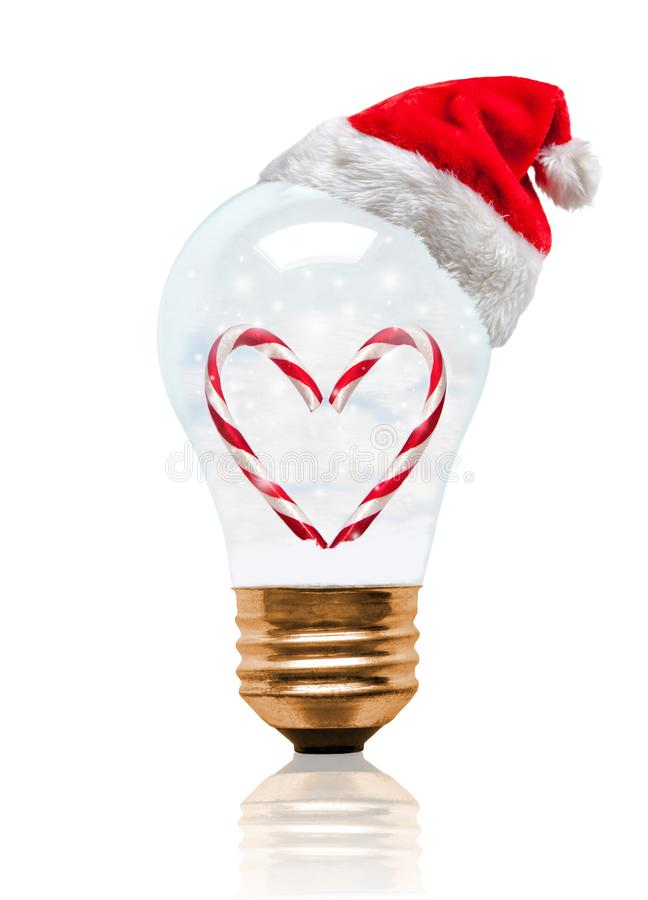 Romantic Snow Globe Light Bulb Candy Cane With Santa Hat And Copy Space royalty free stock photos