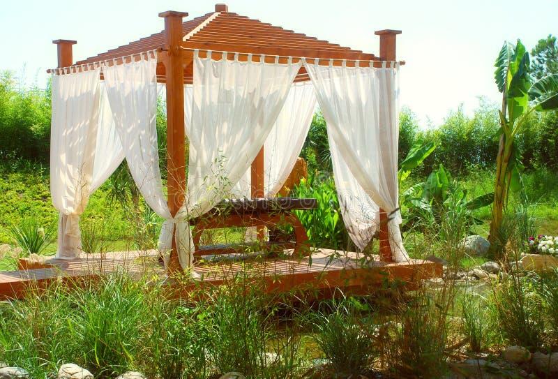 Romantic Spa Pavilion With Curtain Stock Photo