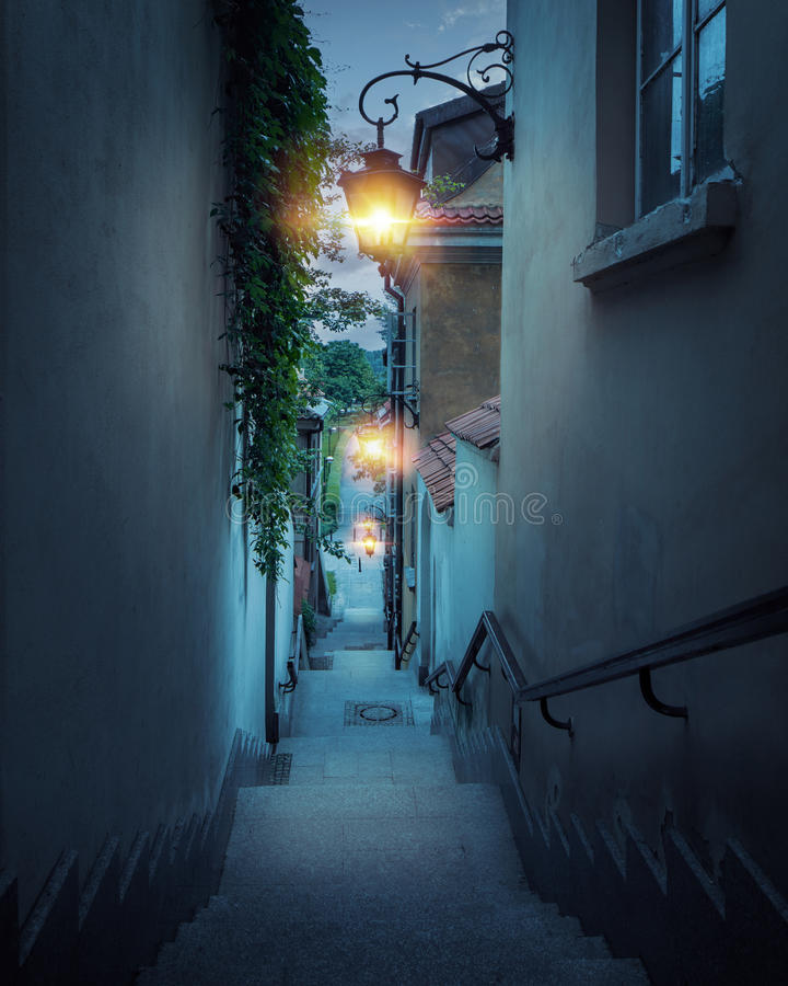 Romantic street of the old town in Warsaw at night royalty free stock photo