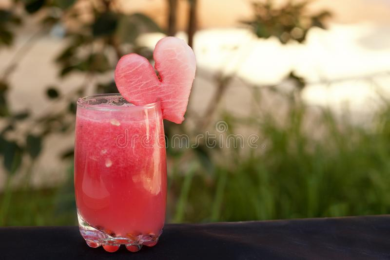Romantic summer cocktail from watermelon. Healthy summer time juice stock photo