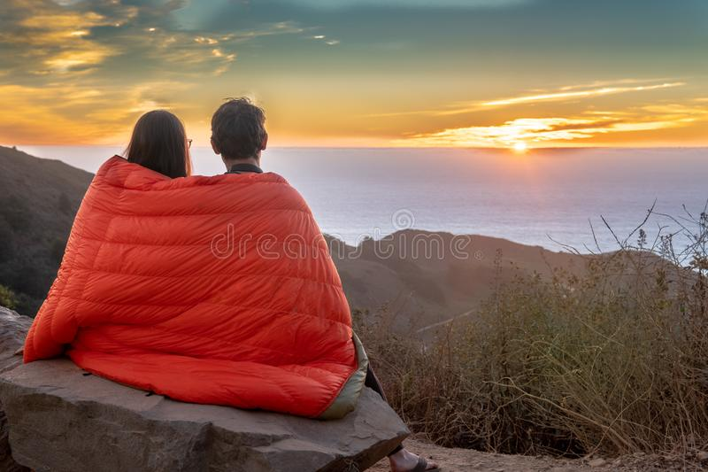 Romantic Sunset of couple cuddling under blanket. Sunset at our camp site in Los Padres National Forest near Highway 1 - California, USA royalty free stock images