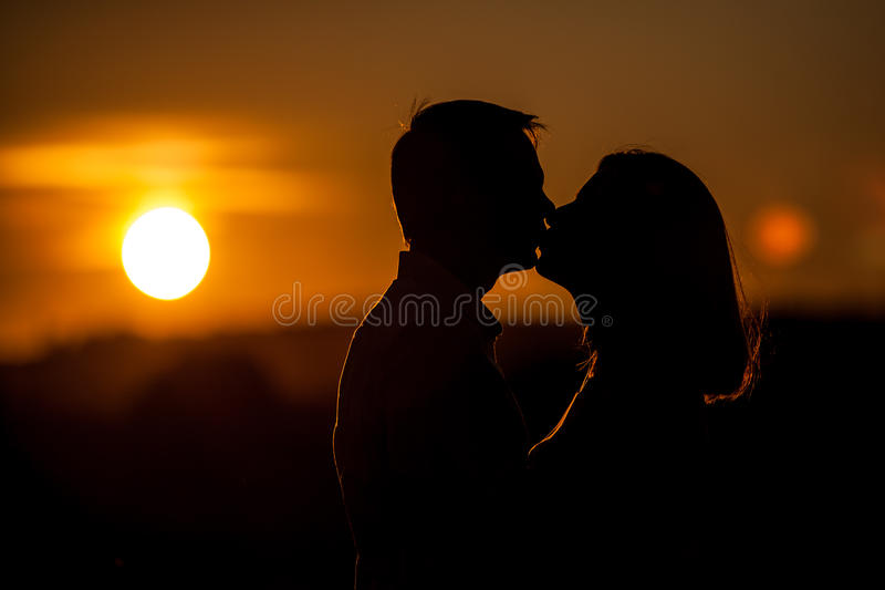 Romantic sunset kiss royalty free stock images