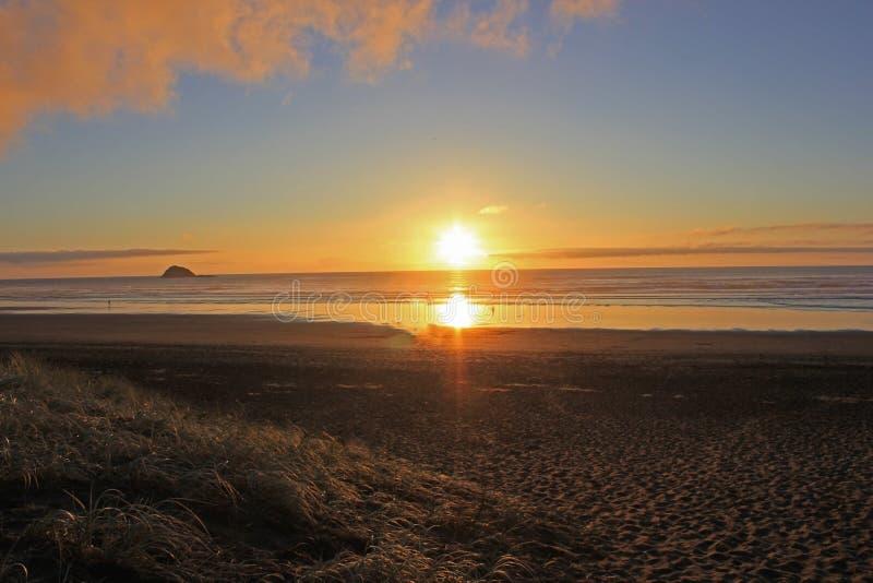 Romantic sunset at muriwai beach stock images