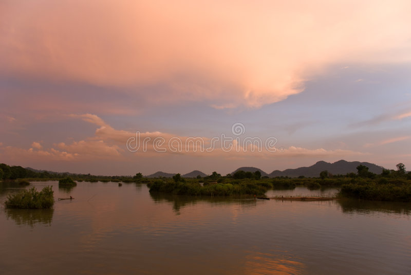 Romantic sunset on a river. In southern laos royalty free stock photo