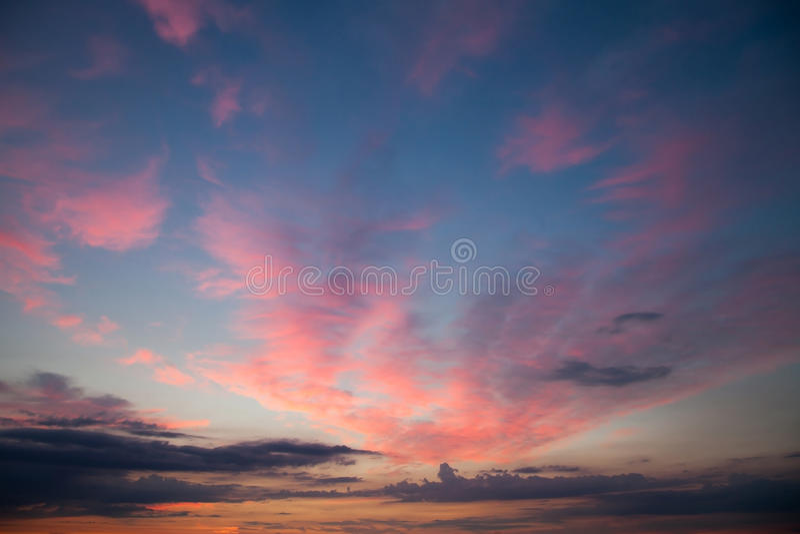 Romantic sunset sunrise sky with dark blue clouds. Romantic sunset sunrise sky with dark, blue clouds royalty free stock photography