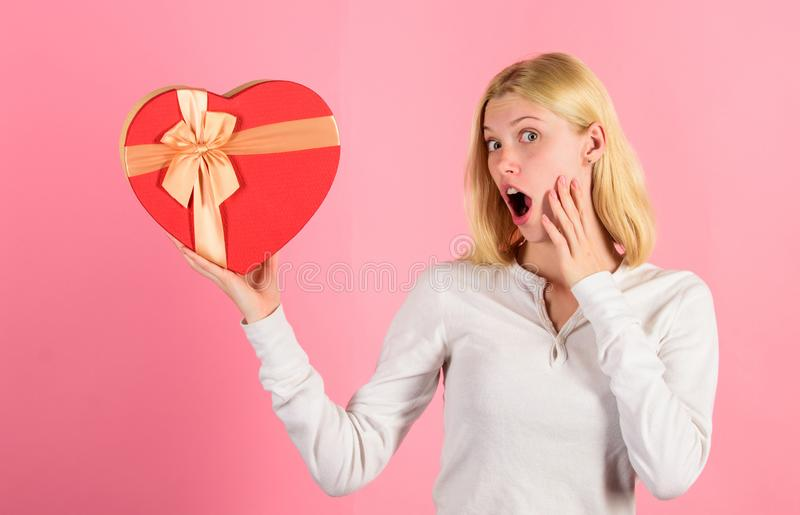 Romantic surprise gift for her. Heart melting valentines day gifts that every girl wants. Woman hold heart shaped gift royalty free stock image