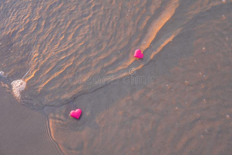 Love symbol of heart on the sea beach. Romantic symbol of heart on the sea beach stock image