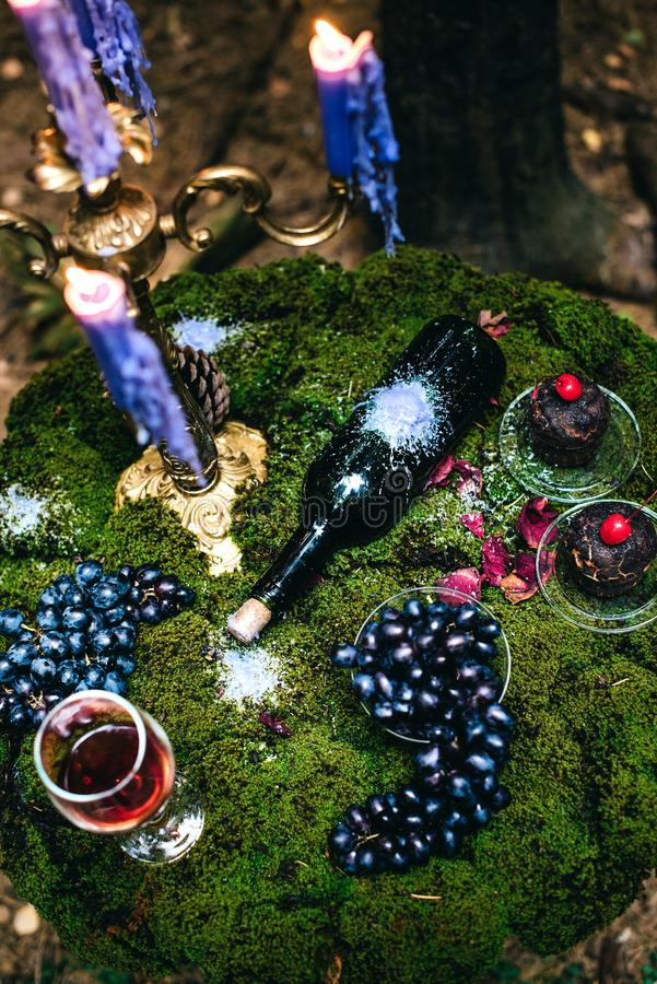 Romantic table with moss, candles dripping royalty free stock photo