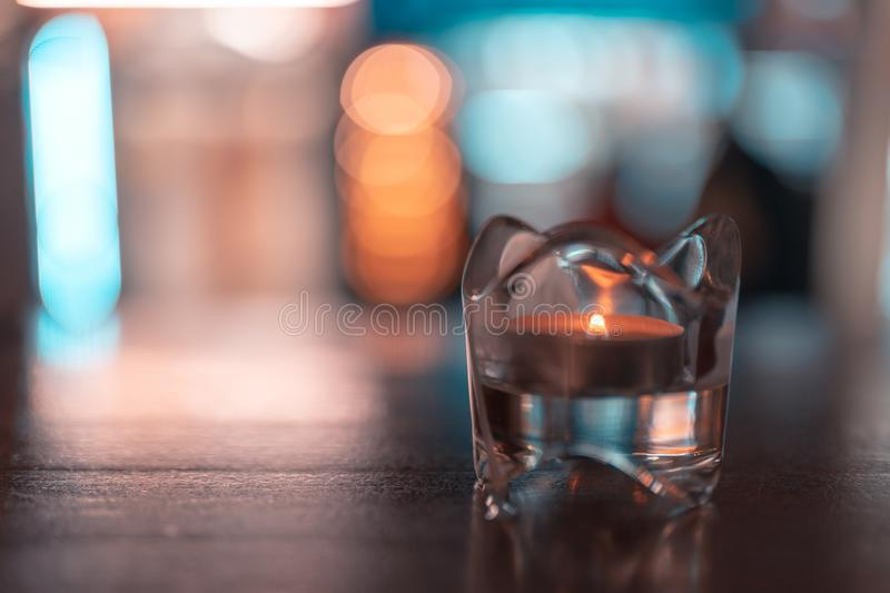A romantic tealight in the dark on a table. A romantic tealight in the dark on a table royalty free stock image