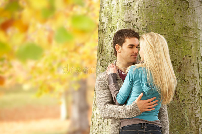 Download Romantic Teenage Couple By Tree Stock Image - Image: 13671535