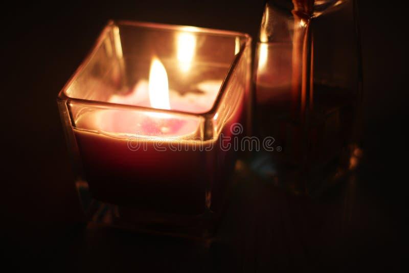 Romantic theme: candle and few aroma sticks. Romantic theme: fire of candle and aroma sticks royalty free stock photos