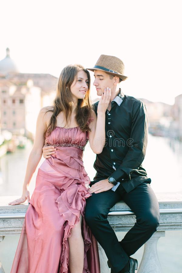 Romantic travel couple in Venice on Gondole ride romance in boat happy together on travel vacation holidays. Romantic young beauti royalty free stock images