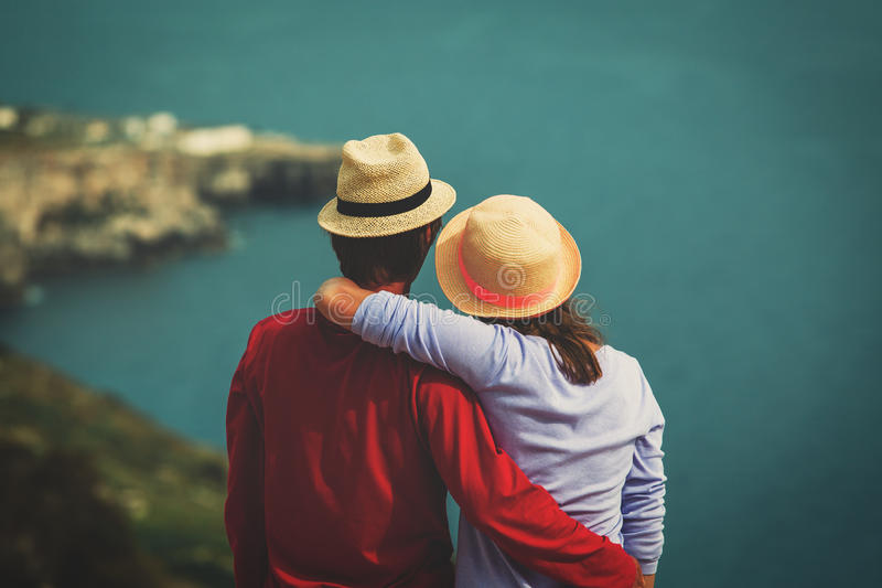 Romantic travel - happy young loving couple on sea vacation stock image