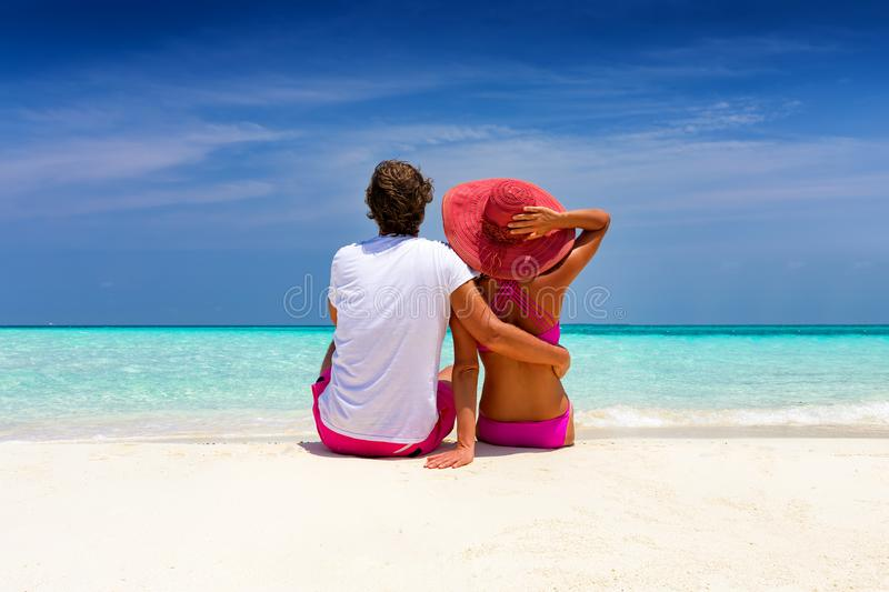 Romantic traveller couple sits on a tropical beaches royalty free stock photography