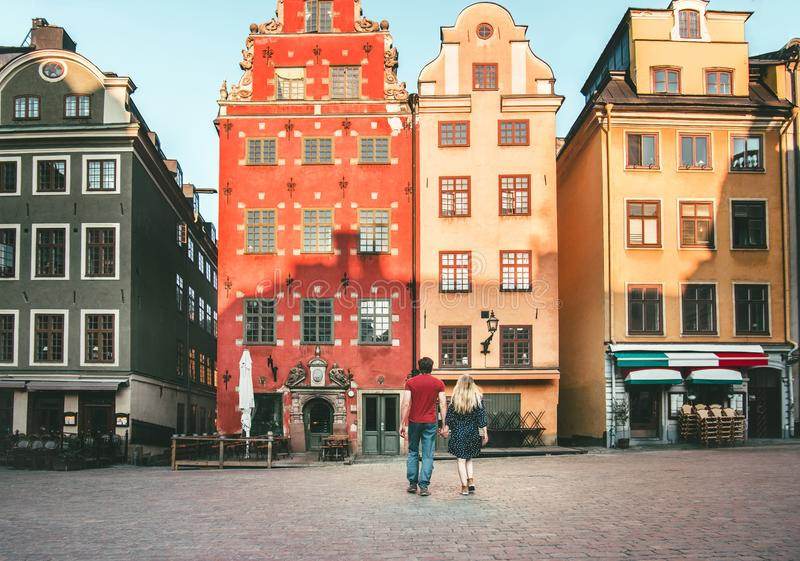 Romantic vacations couple in love traveling together in Stockholm. Stortorget architecture colorful houses Sweden landmarks royalty free stock images