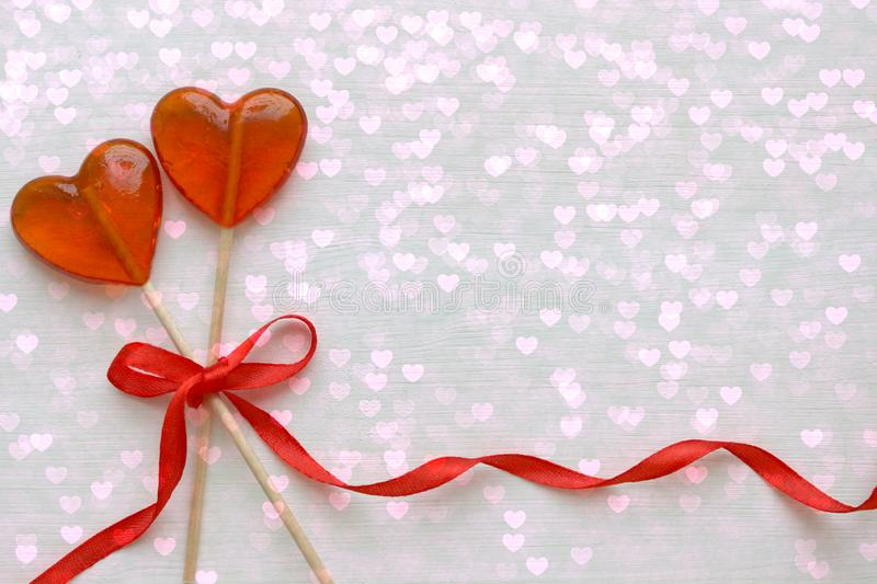 Romantic Valentine`s day background. Lollipops in the shape of heart close up on white background. Copy space royalty free illustration