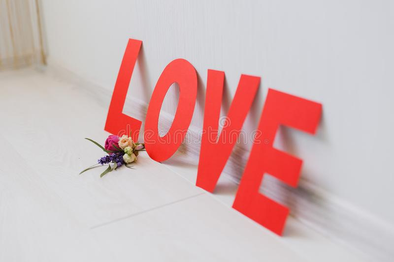 Romantic Valentine`s Day paper love inscription with flowers royalty free stock image