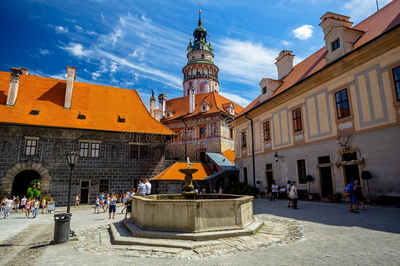 Romantic View of the Castle Tower and Fountain in the Courtyard in Cesky Krumlov. On a Summer Sunny Day royalty free stock photos