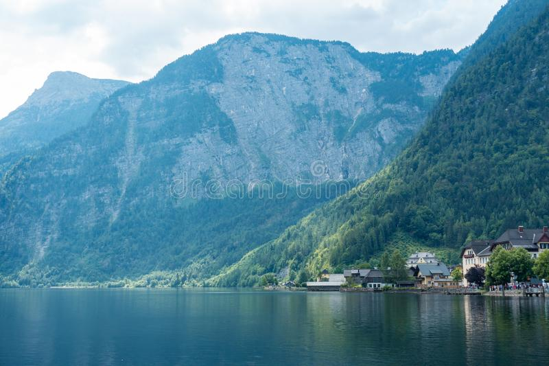 Romantic view on cute houses with lake and mountains, Salzburg, Austria royalty free stock photography