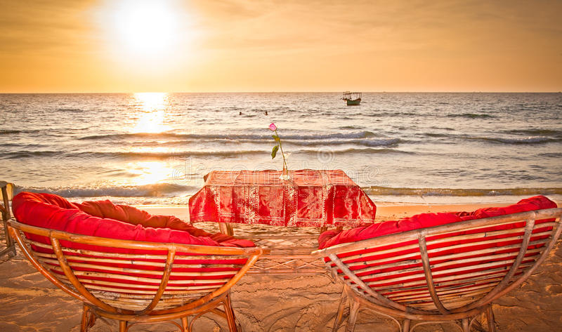 Romantic view to the orange sunset sky in Cambodia. Two Chairs with romantic view to the orange sunset sky in Cambodia stock photo