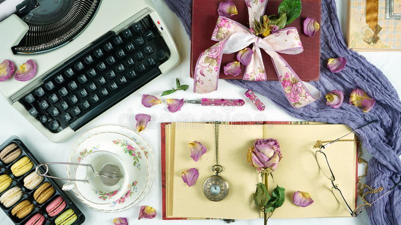 Romantic vintage feminine writing desk stop motion with old typewriter. royalty free stock photography