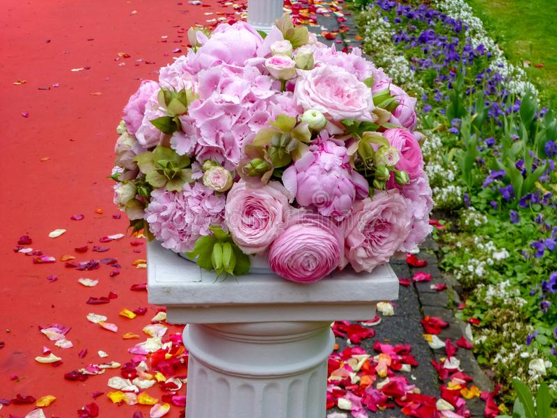 Romantic wedding decor, floral decoration, pink wedding bouquet with different flowers royalty free stock photography