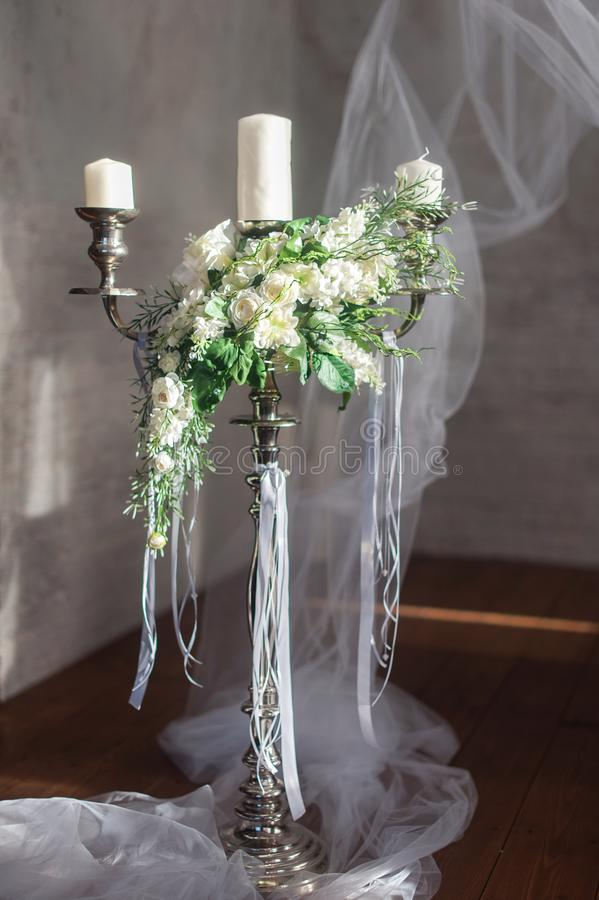 Romantic wedding flower bouquet with candlestick royalty free stock photography