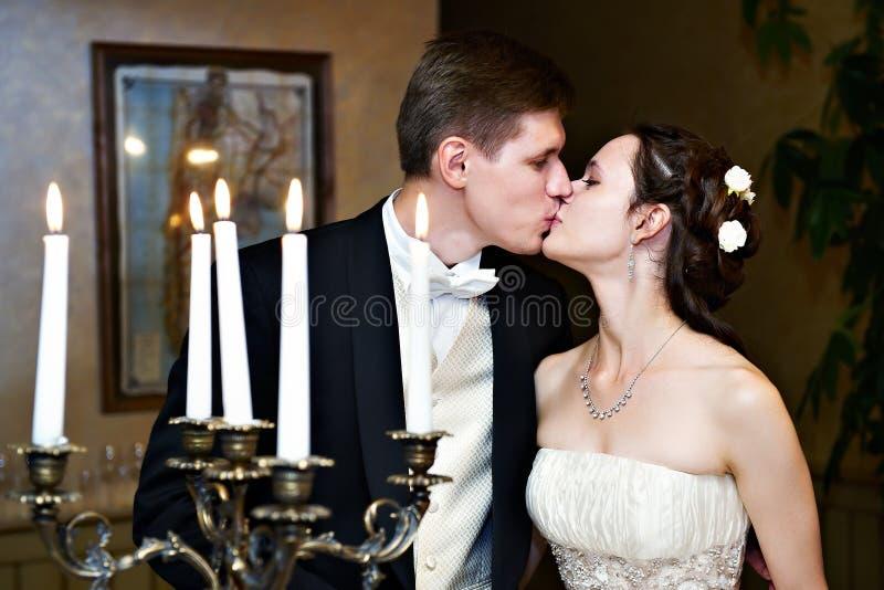 Romantic wedding kiss stock photos