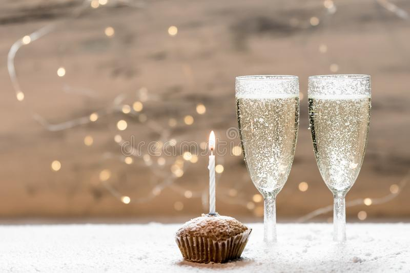 Romantic, white and golden winter background with two glasses of champagne royalty free stock photos