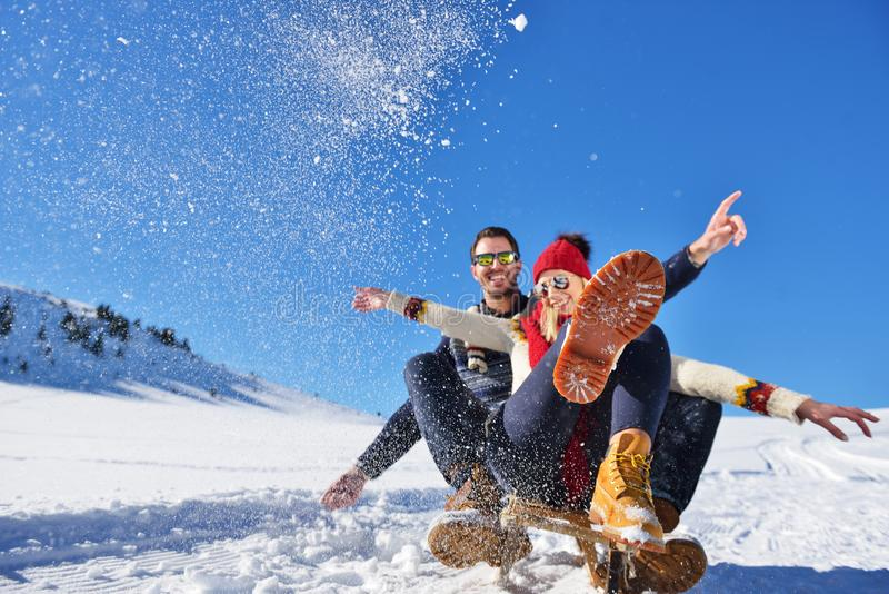 Romantic winter scene, happy young couple having fun on fresh show on winter vacatio, mountain nature landscape.  royalty free stock image