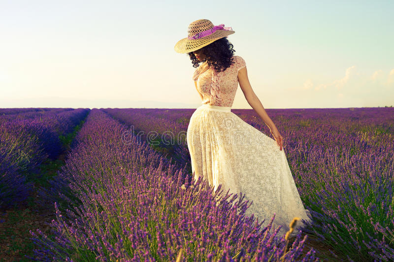 Romantic woman in fairy lavender fields royalty free stock photography
