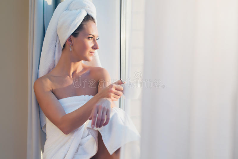 Naked Girl With Towel On Head Touches Body Stock