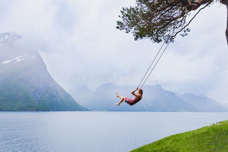 Romantic woman on swing, dream and inspiration stock image