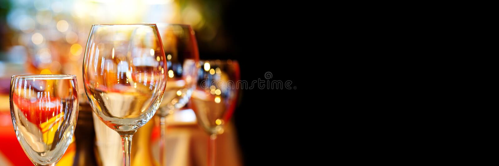 Romantic xmas restaurant interior with beautiful crockery tableware. Crystal wine glasses holidays event background. Luxury party celebration or banquet royalty free stock photography