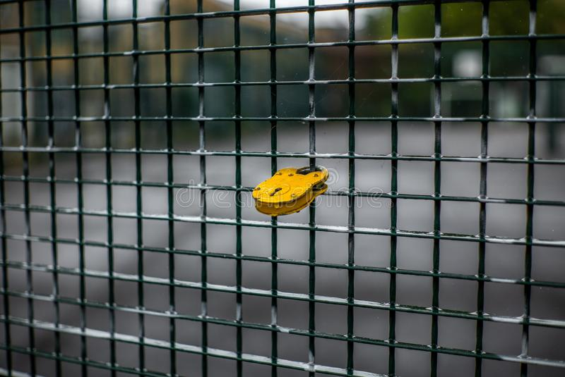 A romantic yellow love lock on a fence in London. 1 stock photo