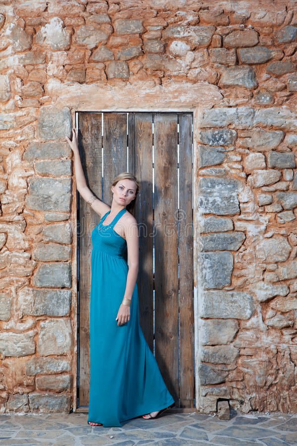 Romantic Young Blond Woman On Stone Wall Back Stock Photo
