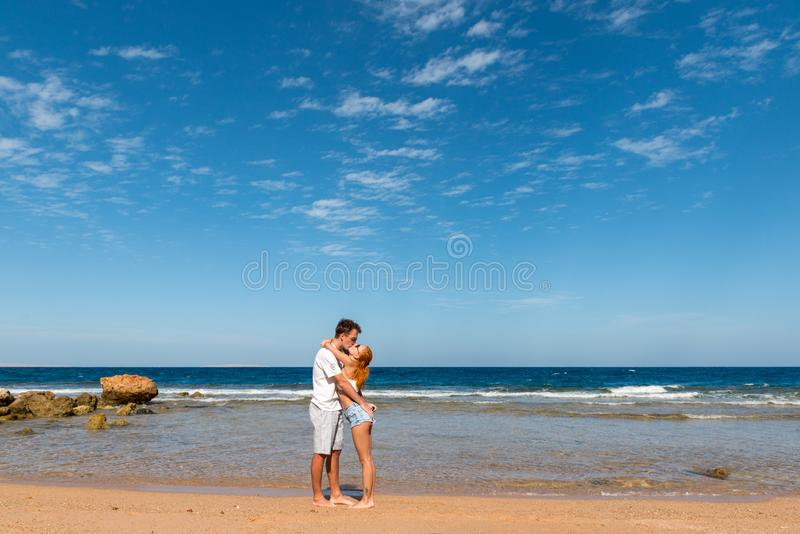 Romantic young couple on the beach royalty free stock image