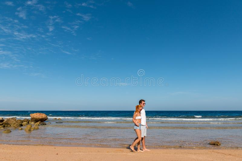Romantic young couple on the beach royalty free stock photos