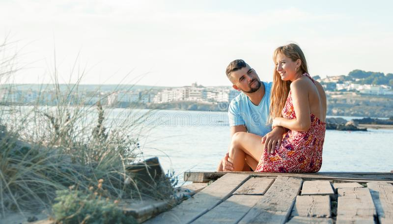 Romantic young couple on the beach. Young couple enjoy each other on vacation. royalty free stock photos