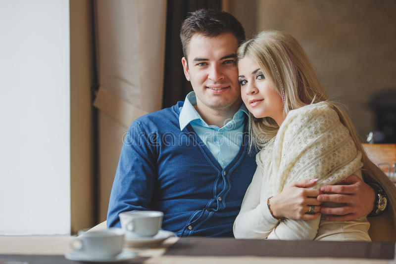 Romantic Young Couple Embracing and having fun indoor royalty free stock photos