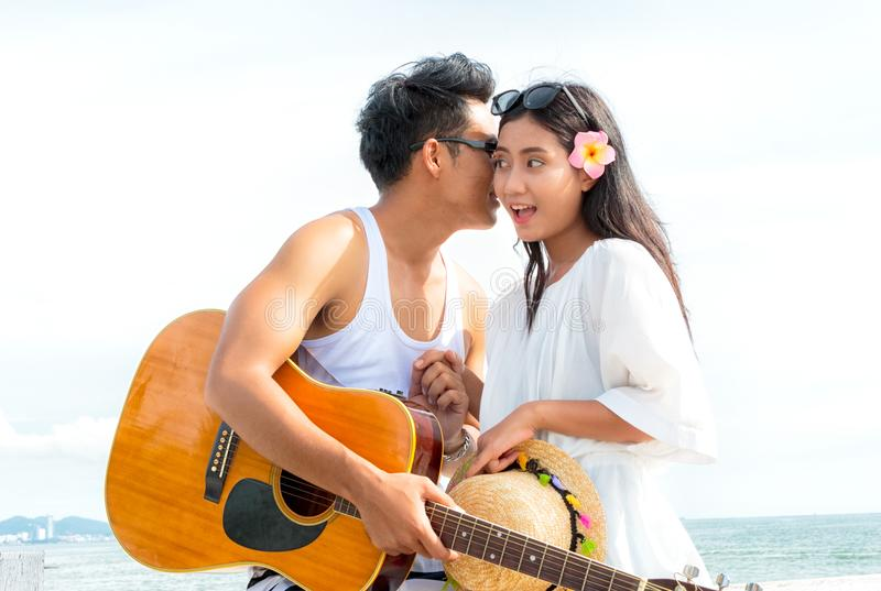Romantic couple with guitar. Romantic young couple with guitar royalty free stock photos