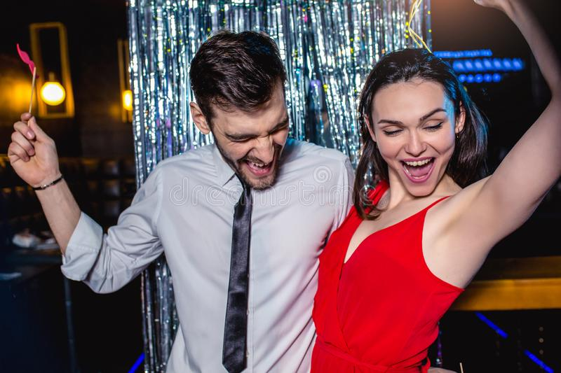Young couple having fun in the night club. Man and woman in the pub royalty free stock photography