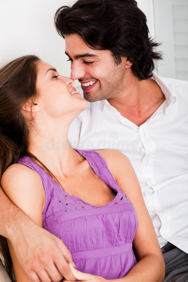 Romantic young couple kissing eachother royalty free stock images