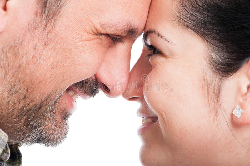 Romantic young couple touching their foreheads royalty free stock image