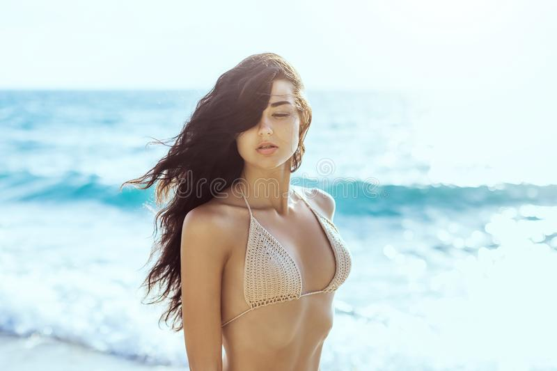 Portrait of beautiful young woman on beach. stock photography