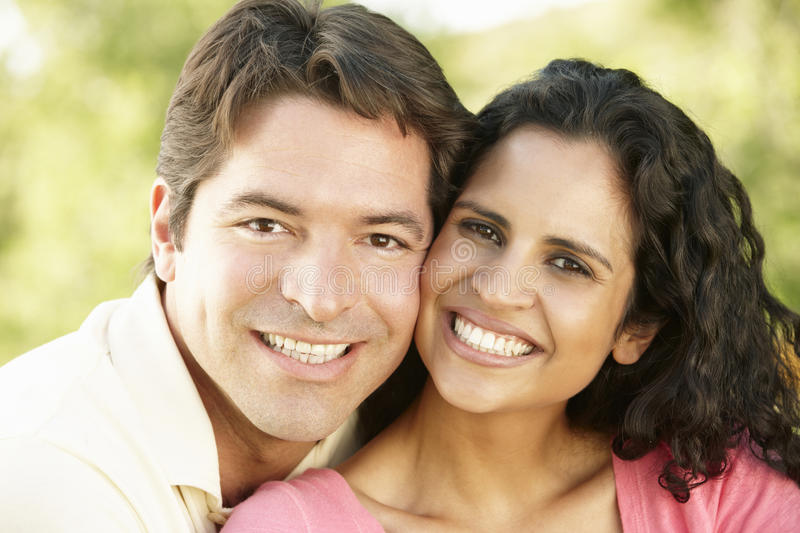 Romantic Young Hispanic Couple Relaxing In Park stock photos