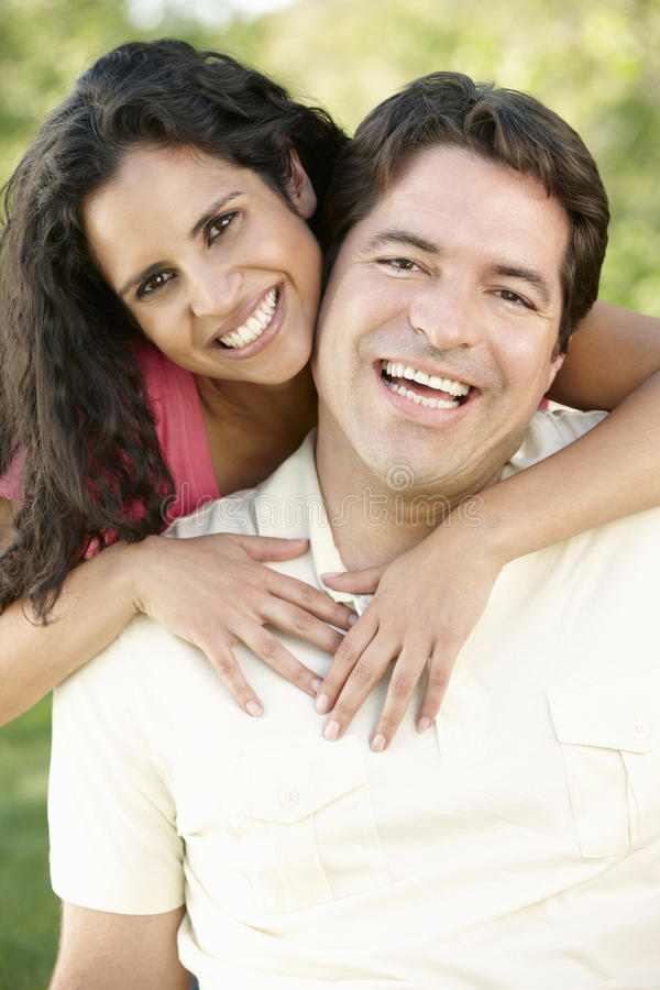 Romantic Young Hispanic Couple Relaxing In Park royalty free stock photos