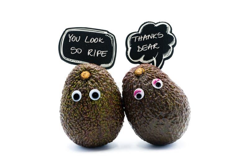 Romantisch avocado'spaar met googly ogen stock afbeeldingen