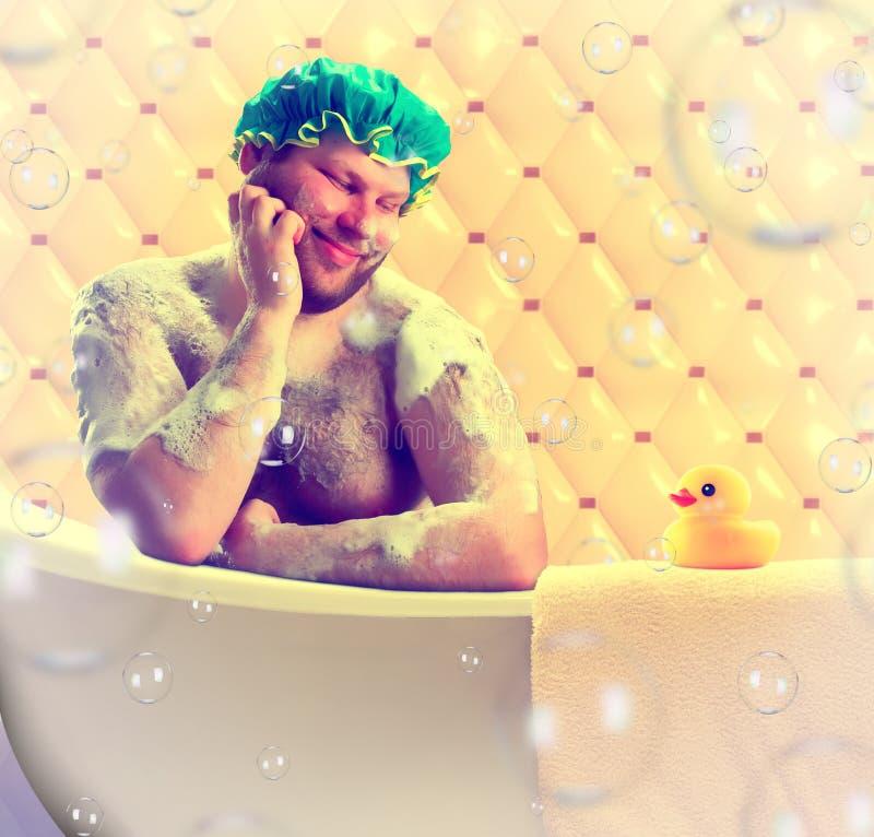 Romantische escapist die bad neemt stock foto's