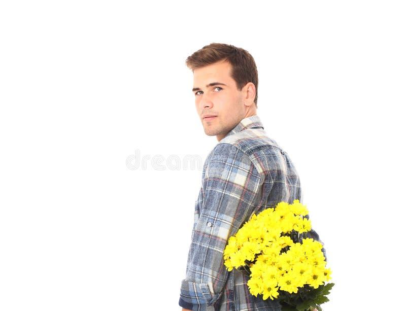 Romantische jonge mens met boeket van gele die bloemen op wit wordt geïsoleerd valentine Moeder en Dochter Verjaardag royalty-vrije stock afbeelding